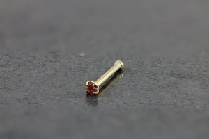 14kt Yellow Gold 1.5mm Pink Nose Bone