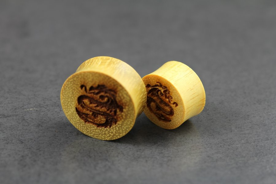 Image of Dragon Engraved Wooden Plugs