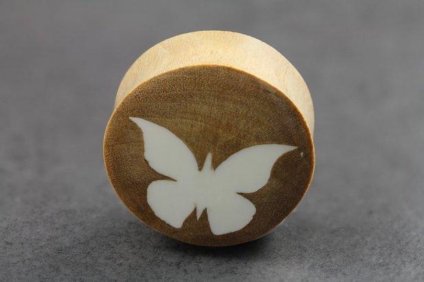 Image of White Butterfly on Clove Wood body piercing jewellery NZ