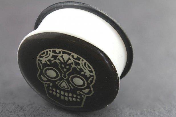 Image of Acrylic Glow in the Dark Skull Single Flared Plugs body piercing jewellery NZ