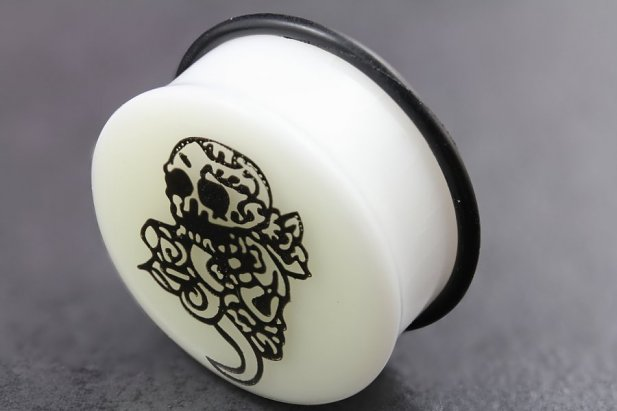 Image of Acrylic Glow in the Dark Skull & Tail Flared Plugs body piercing jewellery NZ