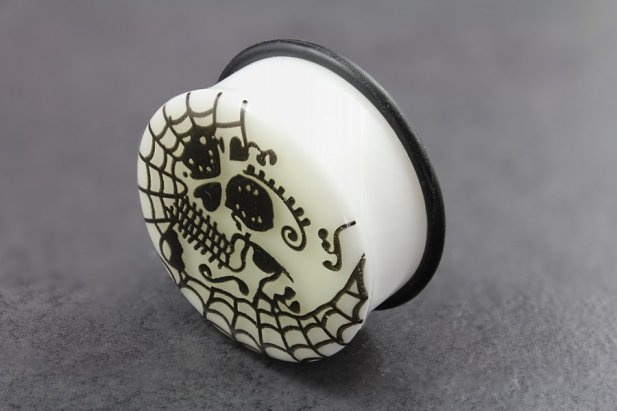 Image of Acrylic Glow in the Dark Skull Web Flared Plugs body piercing jewellery NZ