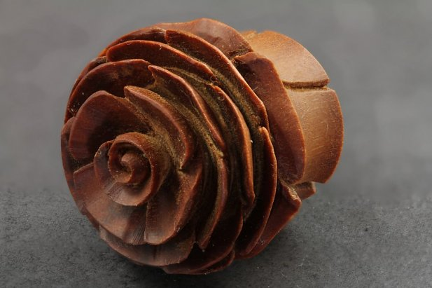 Image of Carved Flower Sawo Wood Plugs body piercing jewellery NZ