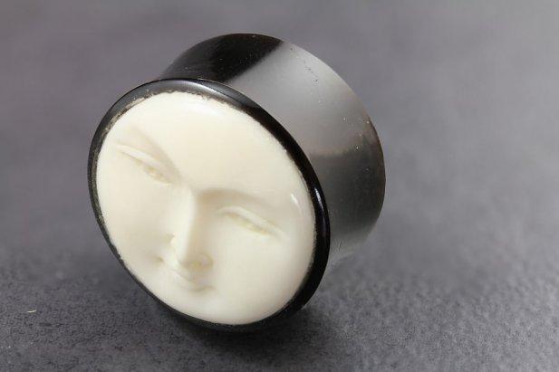 Image of Dark Horn and Bone Moon Face Plugs body piercing jewellery NZ