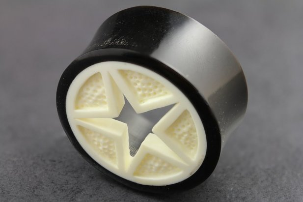 Image of Carved Bone and Horn Star Flared Plugs body piercing jewellery NZ