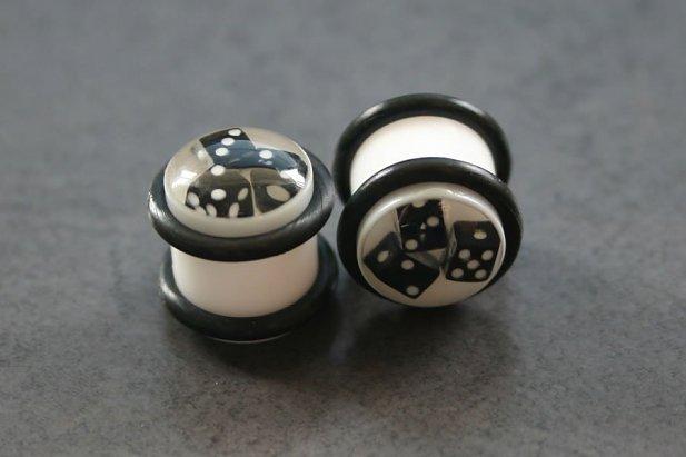 White Plugs with Black Dice